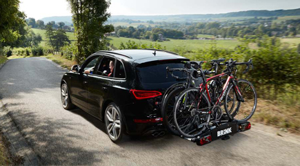 Trailer versus bicycle carrier. Which of the two causes the heaviest load?